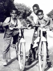 In this circa 1950 photograph taken in Summit-Argo, Illinois, Emmett Till (left) sits on a bicycle beside his cousin, Wheeler Parker (right) with his passenger, Joe Williams.