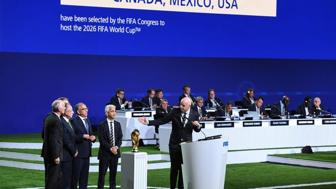 FIFA president Gianni Infantino (R) addresses the United 2026 bid (Canada-Mexico-US) officials Carlos Cordeiro, president of the United States Football Association, president of the Mexican Football Association Decio de Maria Serrano, Steve Reed, president of the Canadian Soccer Association, following the announcement of the 2026 World Cup host during the 68th FIFA Congress at the Expocentre in Moscow on June 13, 2018. / AFP PHOTO / Kirill KUDRYAVTSEVKIRILL KUDRYAVTSEV/AFP/Getty Images ORIG FILE ID: AFP_15W32L