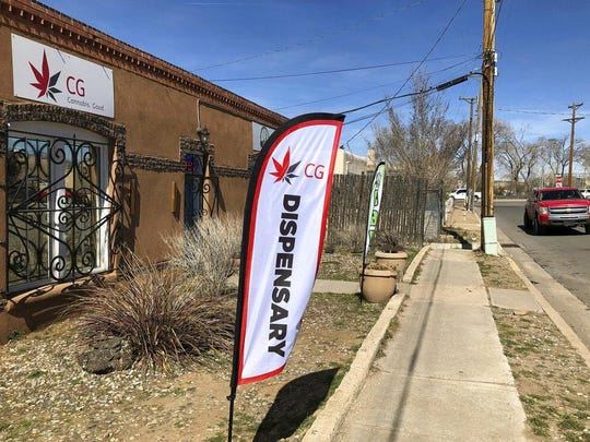 In this Wednesday, March 6, 2019 photo, the exterior of a medical marijuana dispensary is seen in Santa Fe, N.M. New Mexico took a step toward legalizing recreational marijuana when its House approved a bill that would allow state-run stores and require customers to carry a receipt with their cannabis or face penalties.
