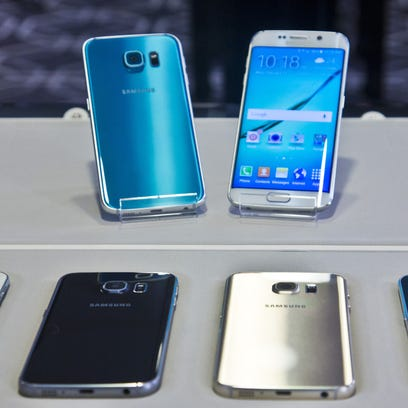 Two new Samsung phones, Galaxy S6, top left, and Galaxy S6 Edge, to right, are on display with choice of color selections at a special media preview in February in New York. Orders for Samsungs Galaxy S 6 phones start Friday with delivery around April 10.