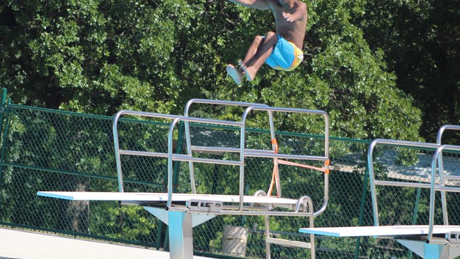 An unidentified youth leaps from the diving board last week at the city of Durant's swimming pool, located at Carl Albert Memorial Park. The pool opened earlier this month for the summer season.