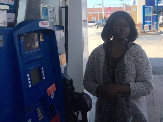 Linda Bowers fills her gas tank at the Exxon station in Newport on Tuesday. Congestion from roadwork on Del. 141 has caused her to take city streets to Wilmington for work, she said.