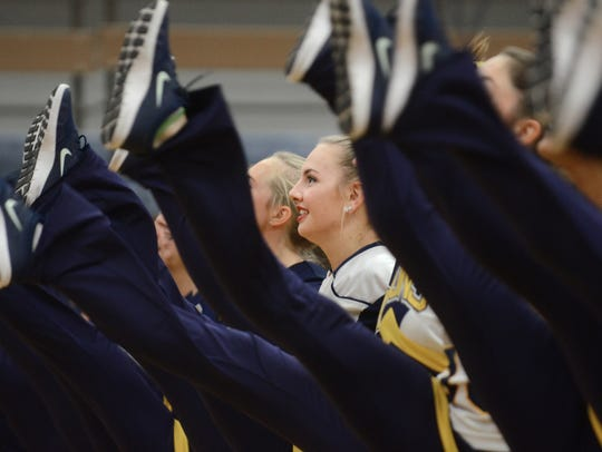 Members of South Lyon High's pompon squad rehearse