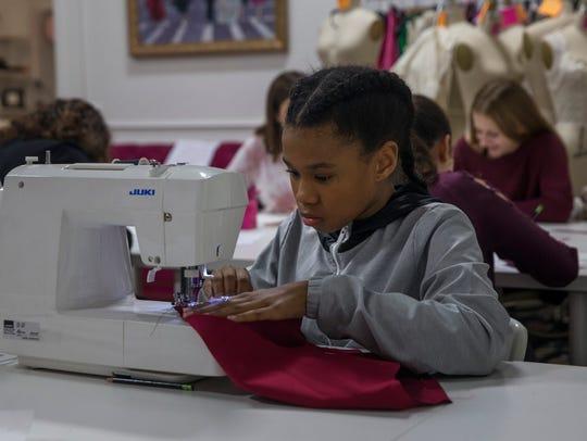 Taylor Moss, 13, of Linden, NJ, sews an outfit at Karen's