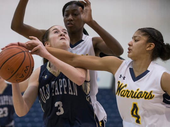 NV/Old Tappan's Noelle Gonzalez get pressure from Franklin's Camille Gray and Diamond Miller. NV/Old Tappan vs Franklin Girls Basketball in NJSIAA quarterfinal game at Toms River on March 14, 2018