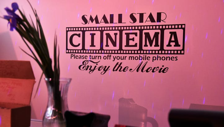 A sign behind the counter at Small Star Art House asks