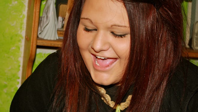 The pictures show a vibrant, happy young woman, which is how her parents describe her when heroin wasn't in control.