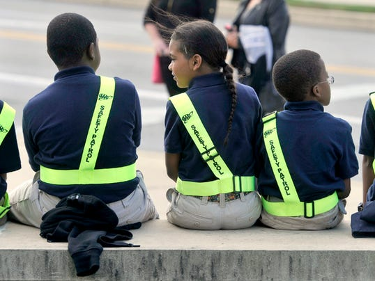 Students from the Safety Patrol at Lincoln Charter School sit on a wall while waiting to meet with students from the York College group Enactus on Friday, Oct. 16, 2015. The college group was leading a training seminar for students from the charter school, teaching them about respect.  Jason Plotkin - York Daily Record/Sunday News