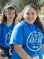 Hatch Middle School's Isabel Perez, 12, attends the Young Achievers Forum with friends on Saturday February 11, 2017 at New Mexico State University.