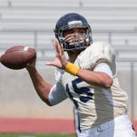 Tyler Stewart passes the ball during the Nevada football team's annual Silver and Blue spring game last season.