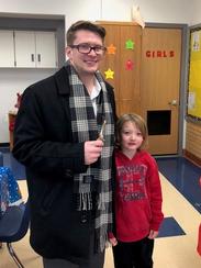 From left, mentor Matthew Gregor and student Brenton Diller participate in Woodrow Wilson Elementary School's lunch buddy program.