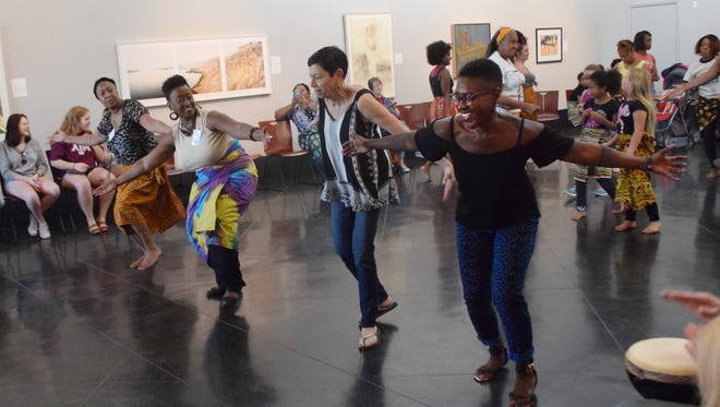 Anne Angelle (far left), Karen Riley Simmons, Sally Bindursky Finklea and Cynthia Shelton dance during a workshop teaching basic African dance techniques. Sankofa Cultural Collective presented a free Afrikan drumming and dance workshop Saturday, Oct. 10, 2015 at the Alexandria Museum of Art. Members of Bamboula 2000 of New Orleans instructed participants in basic African drumming and dance techniques.