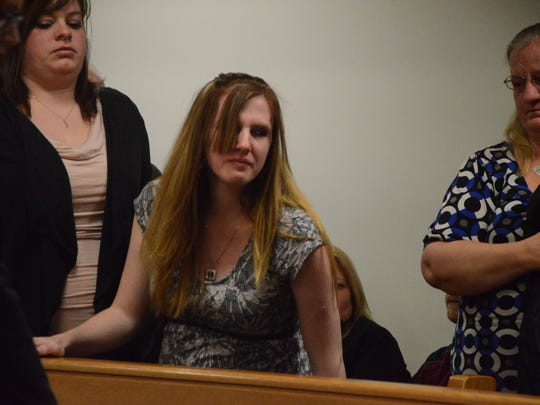 Brianna Richards, the mother of Athena Ramey, leaves the courtroom after the murder arraignment of her fiance.
