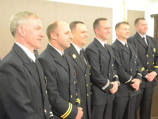 Battle Creek Fire Chief David Schmaltz, third from