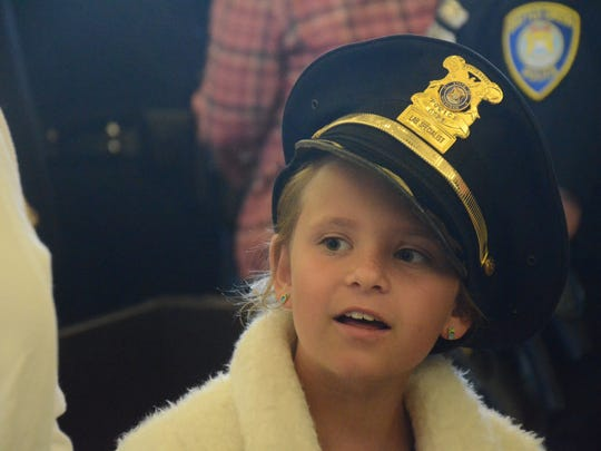 Officer of the Year Todd Rathjen's granddaughter, Alison, 8, wore his hat after the ceremony Tuesday.