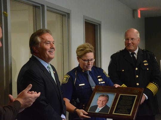 State Sen. Mike Nofs was presented with a plaque naming a room at the building in his honor. Sheriff Matt Saxton, left, along with State Police Commander Col. Kriste Kibbey Etue and Marshall Chief James Schwartz made the presentation.