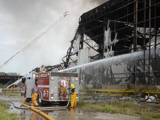 Firefighters battle the fire at a part of the old Clark Equipment Co. building.