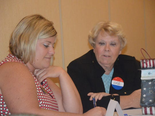Chamber president Kara Beer, left, interviews Mayor Deb Owens.