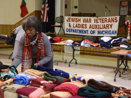 Fannie Myers of Wayne, a volunteer with the Jewish War Veterans, sort handmade lap blankets for the veterans.
