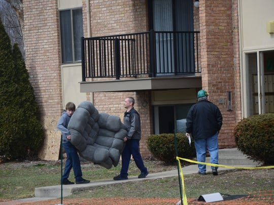 Residents were allowed in the burned Arbors building Thursday to retrieve personal property.