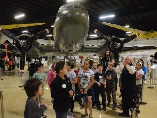 A student group is learning about many of the planes and when they were used.