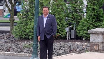 Town of Clarkstown Supervisor Alexander Gromack stands under one of the unique lampposts on Lake St. in Congers April 16, 2014. Each of the town's hamlets have their own unique light poles, offering a bit of unique character to the hamlets.