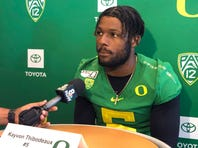 In this Aug. 2, 2019, photo, Oregon defensive end Kayvon Thibodeaux speaks to reporters at the NCAA college football team's media day in Eugene, Ore. Thibodeaux is a five-star recruit who should see playing time as a true freshman. (AP Photo/Anne M. Peterson)