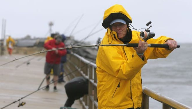 Bill Truex of Brielle casts a line as he spends a rainy morning fishing in the Manasquan Inlet in Manasquan, NJ,May 6, 2016.