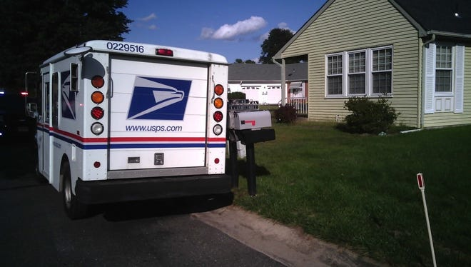 A Whiting woman remains hospitalized after being struck by a postal truck.