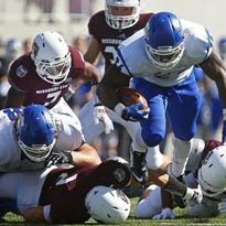 Indiana State Sycamores running back Roland Genesy (24) breaks free from Bears defenders on his way to a touchdown during a fourth & 2 run in second quarter action of the Sycamores' game against the Missouri State Bears at Robert W. Plaster Stadium in Springfield, Mo. on Oct. 3, 2015. The run tied the game at 14 and broke the Bears' spirit, leading to a 56-28 victory for the Sycamores.