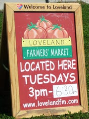 A sign points the way to the Loveland Farmer's Market