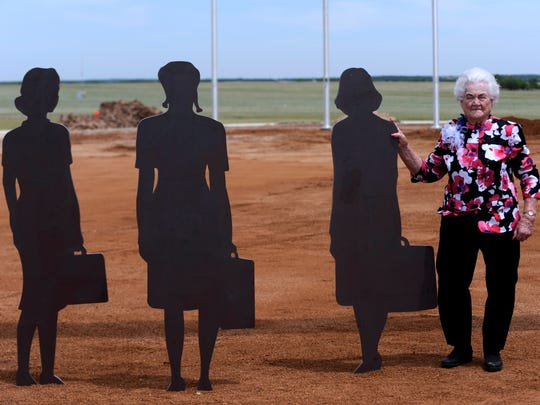 Jessie Lou McReynolds stands beside the steel silhouettes at the National WASP World War II Museum plaza Thursday May 25, 2017. The figures are based upon a historical photograph of new pilots arriving to the Sweetwater school. A new building was dedicated Thursday, designed a replica of the original hangar which trained the Womens Airforce Service Pilots during the war. McReynolds, 95, was a mechanic at the school.