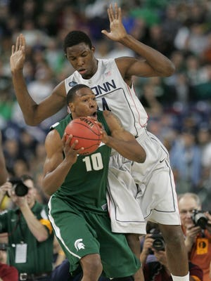 Delvon Roe looks to pass around the defense of Hasheem Thabeet during the Final Four game against Connecticut at Ford Field on April 4, 2009.