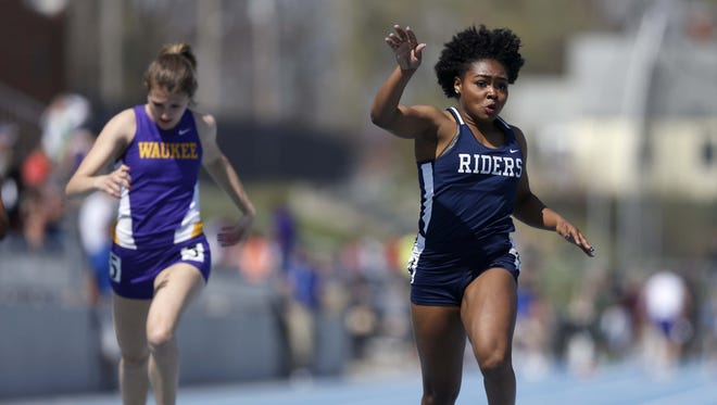 Roosevelt's Briyana Carter cruises to a win and a meet record in the girls 100 meter dash Saturday at the Jim Duncan Invitational at Drake Stadium in Des Moines.