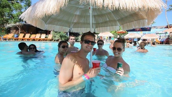 Partiers enjoy the pool at the Caliente Tropics Hotel in Palm Springs on Saturday, Aug. 10, 2013.