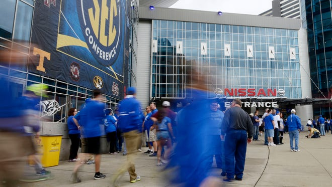 Fans arrive for the SEC Men's Basketball Tournament championship game at Bridgestone Arena, Sunday, March 13, 2016, in Nashville, Tenn.