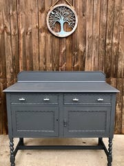 A client's table and cabinet are given an updated and modern look after being lovingly refinished by Ashley Mooneyham.