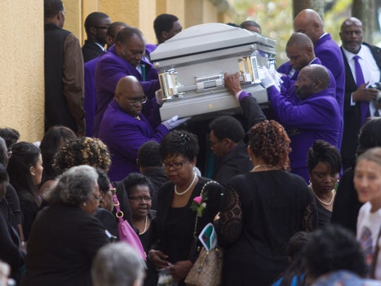Pallbearers carry the casket of Veronica Shoemaker