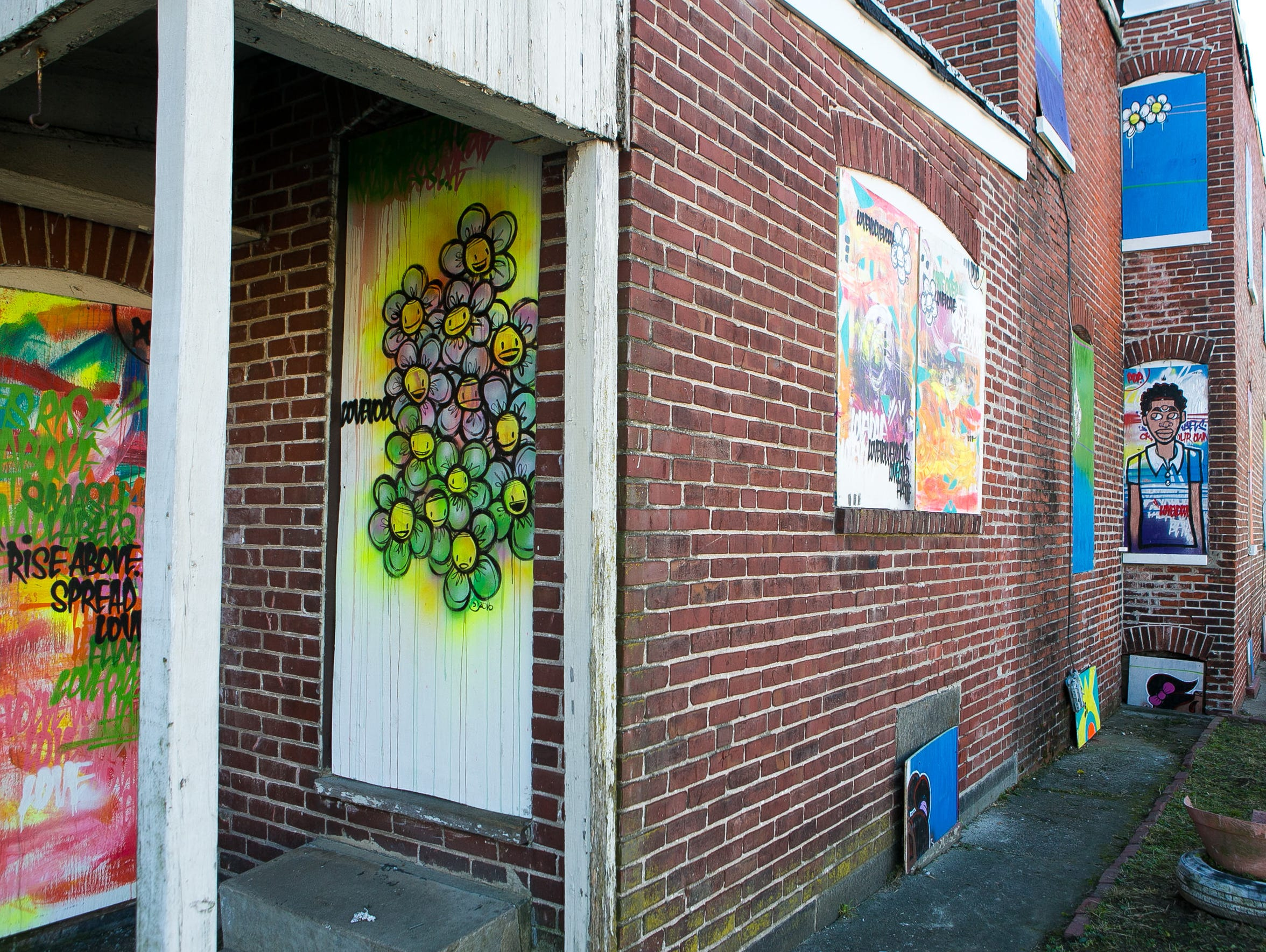 Community art brightens up a vacant home in the Southbridge area.