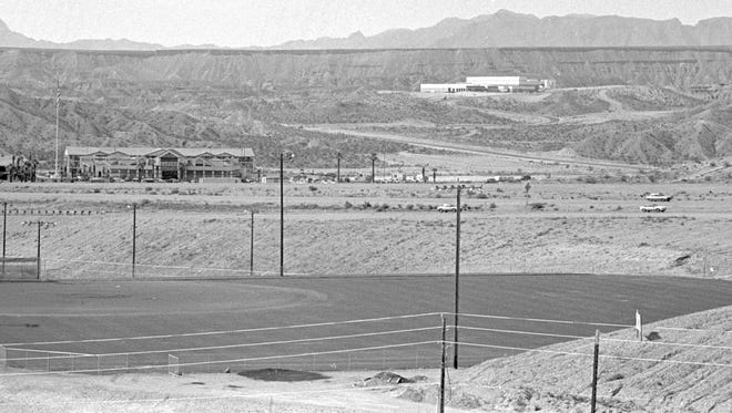 In March of 1992, Spectrum photographer Nancy Rhodes captured the then image of the softball fields in Mesquite. At the time, the only two structures visible on the north side of Interstate 15 were the Virgin River Casino and the Primex Plastics Plant on the hill above it. Nearly a quarter of a century later hundreds of trees, along with golf courses, condos, homes, businesses and other structures have grown up on that side of the freeway as can be seen in the now image taken by Spectrum & Daily News photographer Jud Burkett. In addition, the Virgin River Casino has expanded and the sign for the Eureka Casino, which was builtin 1996, four years after the then image was captured, can be seen as well.