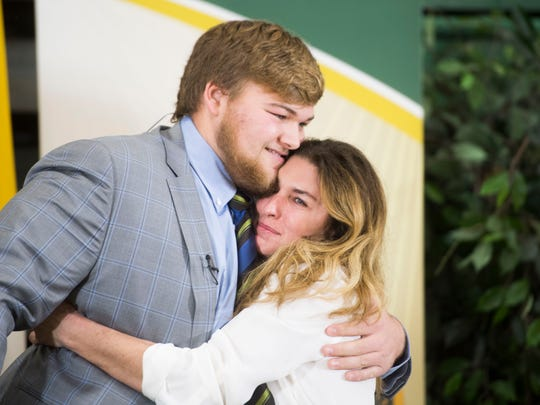 Cade Mays, Knoxville Catholic High School offensive lineman, hugs his mother Melinda, after signing with Georgia at an early signing day ceremony at Knoxville Catholic High School in Knoxville, Tenn., Wednesday, Dec. 20, 2017.