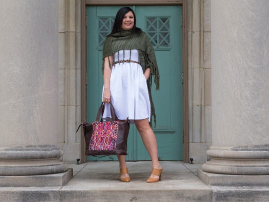 Jessica Persoleo wears a white Amelia Dress with a green sweater wrap and camel-colored Coach high heels.