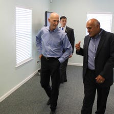 Randy Ramos, right, GBSI founder and CEO, speaking with colleagues.