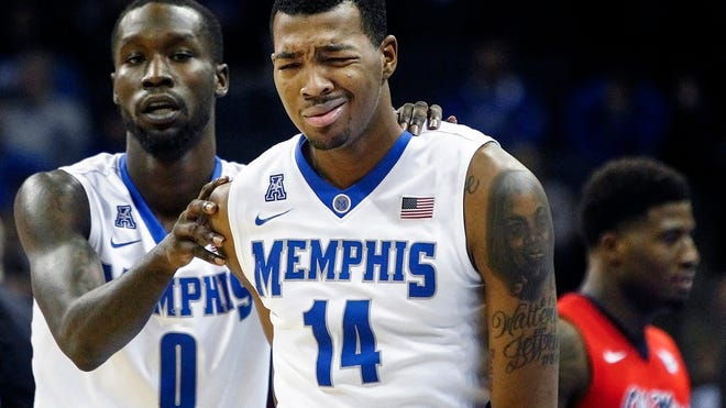 Memphis forward K.J. Lawson (right) and teammate Trahson Burrell.