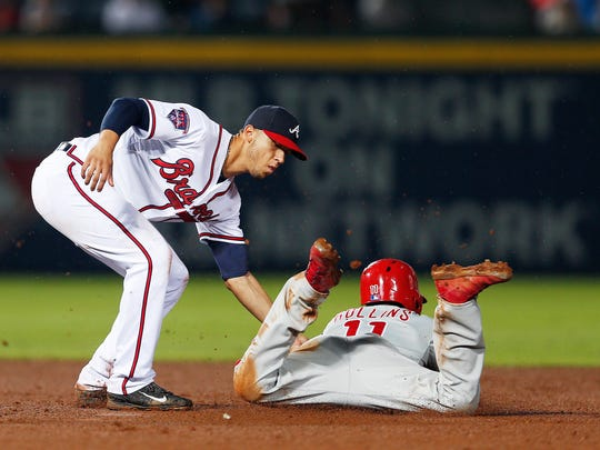 The Phillies' Jimmy Rollins is tagged out by Atlanta Braves shortstop Andrelton Simmons as he tries to steal second base in the eighth inning Friday in Atlanta.