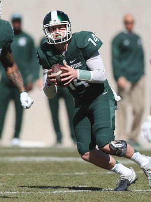Michigan State quarterback Brian Lewerke runs the offense during the spring game at Spartan Stadium, Saturday, April 1, 2017.