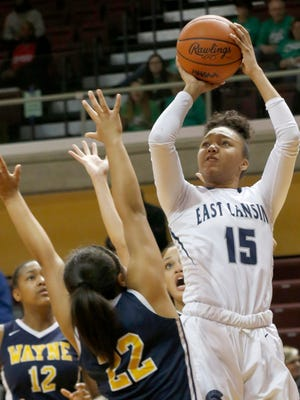 East Lansing's Jaida Hampton shoots the jumper of the defense of Wayne Memorial's Jayah Hicks, left, and Camree Clegg during East Lansing's 60-52 win in the Class A state semifinal at Calvin College's Van Noord Arena in Grand Rapids on Friday, March 16, 2018.
