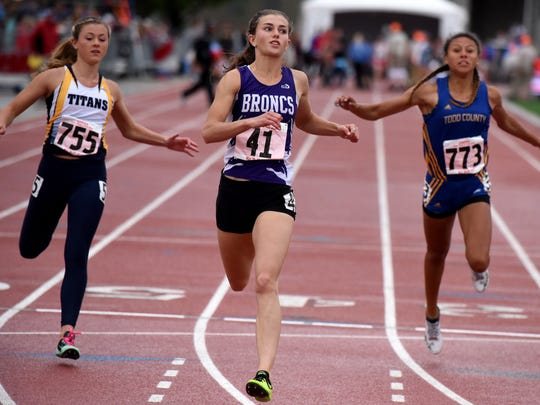 Belle Fourche's Shayla Howell crosses the finish line to win the Class AA girls' 100 meter dash during the State Track and Field Meet on Saturday, May 27, 2017 at Howard Wood Field.