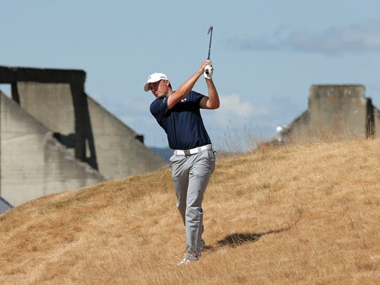 Jordan Spieth hits out of the tall fescue grass on the 18th hole during the second round of the U.S. Open golf tournament at Chambers Bay on Friday, June 19, 2015 in University Place, Wash.