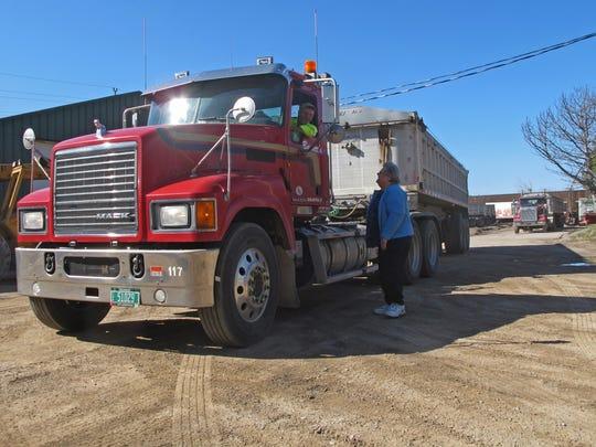 Marie Boisvert talks with Barrett Trucking driver Dale